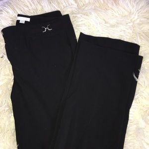 BLACK FLARE TROUSERS. NEW YORK & CO